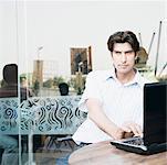 Businessman using a laptop in a restaurant