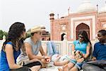 Two young men sitting with three young women, Taj Mahal, Agra, Uttar Pradesh, India