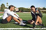 Athletes Sitting on Field