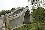 "China, Beijing, Summer Palace ""Yiheyuan"", traditional bridge on the canal leading to Beijing"