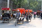 China, Beijing, moving with rickshaw