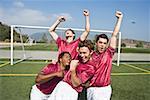 Fußballmannschaft feiern