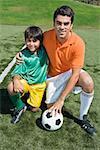 Boy posing with soccer coach