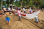 People Hauling Fishing Boat, Bungus Bay, Sumatra, Indonesia