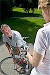 Man inflating woman's bike tire