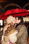 Couple Christmas Shopping, Kissing Under Umbrella