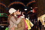Couple Christmas Shopping, Kissing