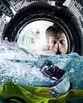 Man Looking at Wallet in Washing Machine