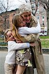 Grandchildren hugging their grandmother