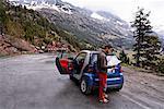 Man Looking at Map at Side of Road, Pyrenees, Aragon, Spain