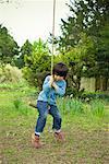 Little Boy on Rope Swing, Puttenham, Surrey, England