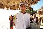 Portrait de garçon à la plage, Mexique