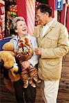 Couple Holding Stuffed Animals at Santa Monica Pier Amusement Park, California, USA