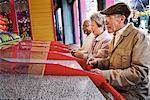 Seniors Playing Amusement Arcade Game at Santa Monica Pier, California, USA