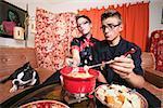 Couple at home having fondue