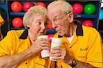 Bowling couple enjoying beverages