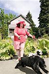 Woman walking Cocker Spaniels