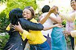 Females hugging outdoors