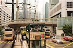 Tram stop on busy street in Hong Kong