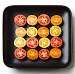 Multicolored tomato slices in dish