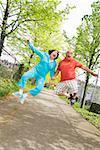 Couple jumping outside