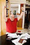 Man celebrating after paying bills