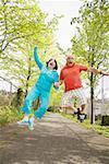 Couple jumping for joy outside
