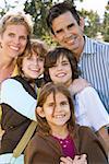 Family posing outside
