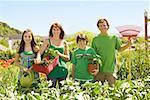 Family in in vegetable garden