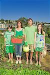 Family in vegetable garden