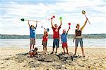 Group of children cheering at beach