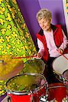 Senior woman playing drums