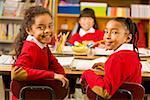 Multi-ethnic girls sitting in classroom