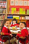 Multi-ethnic girls in classroom