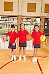 Multi-ethnic girls holding sports balls