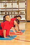 Multi-ethnic girls practicing yoga