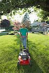 Man Cutting the Lawn