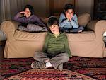 Children on sofa, watching tv