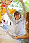 Teenage Boy Celebrating Win at an Amusement Park