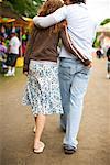 Couple Walking at a Carnival