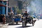 Man Driving Three-Wheeler in Street, Kashgar, Xinjiang Province, China