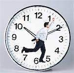 Businessman running on a clock face