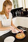 Woman Cutting Homemade Pie