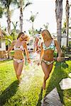 Woman Spraying Friends With Hose, Encinitas, San Diego County, California, USA