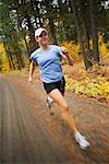 Woman Running in Forest, Methow Valley, Near Mazama, Washington, USA