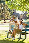Couple Sitting on Bench, Taking a Break From Golfing, Salem, Oregon, USA