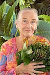 Portrait of Mature Woman Holding Plant