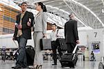 Business executives walking at an airport