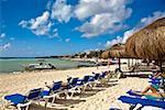 Tourist lying on lounge chairs on the beach, Playa Del Carmen, Quintana Roo, Mexico