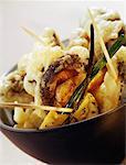 Shiitake tempuras and deep fried tofu with poppy seeds
